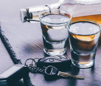 Alcohol sitting next to car keys