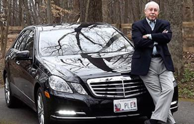 Attorney next to his car